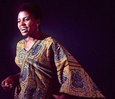 "Miriam Makeba ""I see other black women imitate my style, which is no style at all, but just letting our hair be itself. They call it the Afro Look."""