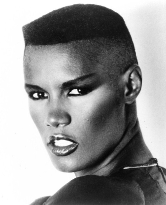 "Grace Jones is a Jamaican singer, lyricist, supermodel, record producer, and actress. In 1977 Jones secured a record deal with Island Records; she moved into dance and new wave music, often collaborating with the Compass Point All Stars. She scored Top 40 entries on the UK Singles Chart with ""Pull Up to the Bumper"", ""I've Seen That Face Before"", ""Private Life"", ""Slave to the Rhythm"" and ""I'm Not Perfect"". Her most popular albums include Warm Leatherette (1980), Nightclubbing (1981), and Slave to the Rhythm (1985)."